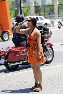Woman saluting riders